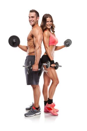 fitness men: Fitness hermosa joven pareja deportiva con mancuerna aislados sobre fondo blanco Foto de archivo