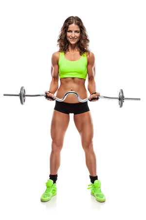 Nice sexy woman doing workout with big dumbbell isolated over white background (retouched) photo