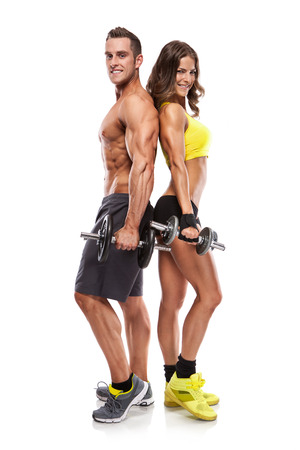 fit on: beautiful fitness young sporty couple with dumbbell isolated over white background