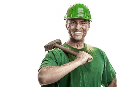 impurity: Young dirty Worker Man With Hard Hat helmet  holding a hammer isolated on White Background
