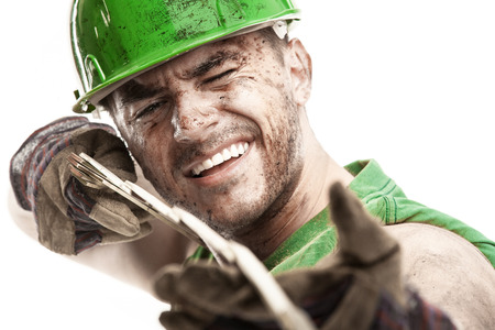 face work: portrait of dirty worker with helmet measuring with classic wood meter isolated on white background Stock Photo