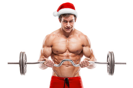 sexy birthday: Muscular bodybuilder Santa Claus doing exercises with dumbbells isolated over white background