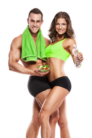 beautiful young sporty sexy couple with salad isolated over white background Stock Photo