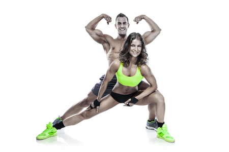 sexy woman nude: beautiful young sporty couple posing and showing muscle isolated over white background