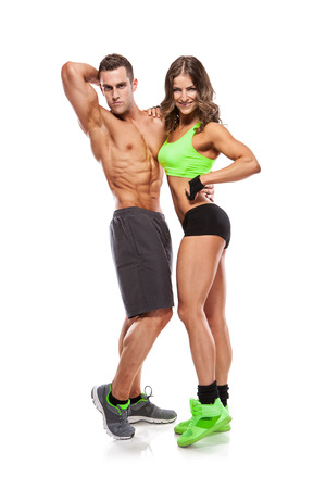 beautiful young sporty sexy couple  isolated over white background