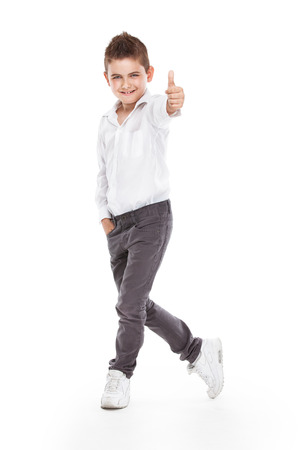 standing young cool boy isolated over white background