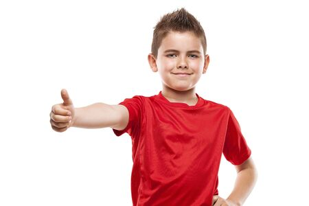 cool boy: standing young cool boy doing thumbs-up isolated over white background