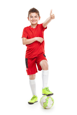 school sports: standing young soccer player with football isolated over white background Stock Photo