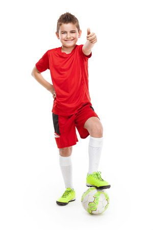 football socks: standing young soccer player with football isolated over white background Stock Photo