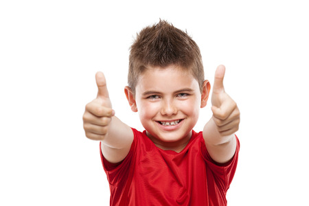 kid portrait: standing young cool boy doing thumbs-up isolated over white background