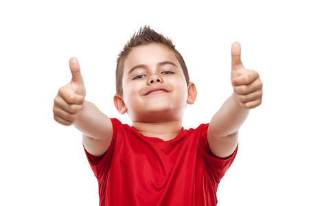 cool kids: standing young cool boy doing thumbs-up isolated over white background