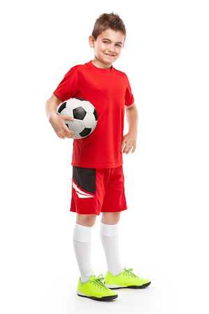 football socks: standing young soccer player holding football isolated over white background