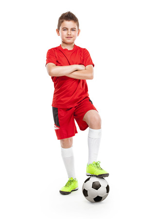 football play: standing young soccer player with football isolated over white background Stock Photo