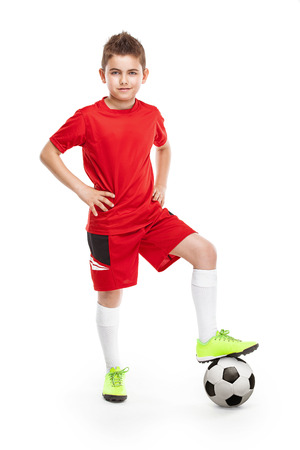 standing young soccer player with football isolated over white background 版權商用圖片