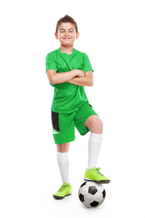 boy shorts: standing young soccer player with football isolated over white background Stock Photo
