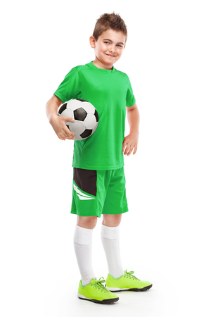 boy shorts: standing young soccer player holding football isolated over white background