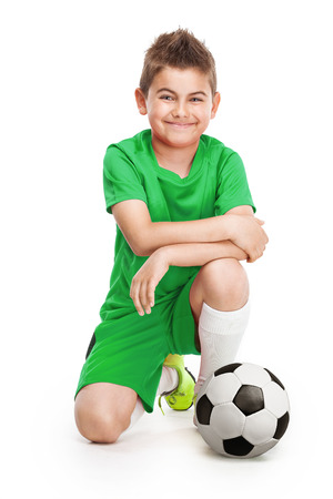 retouched: kneeling young soccer player with football isolated over white background