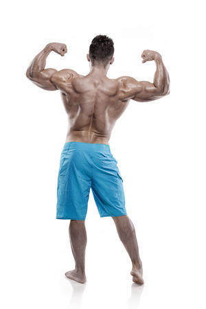 pectorals: Strong Athletic Man Fitness Model Torso showing big back muscles isolated over white background