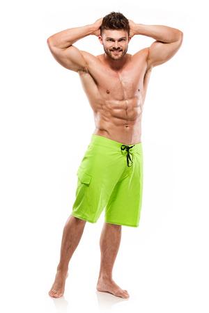 Modelo atlético fuerte de la aptitud del hombre Torso que muestra los músculos grandes aislados sobre el fondo blanco Foto de archivo - 46513311