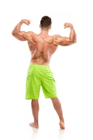 latissimus: Strong Athletic Man Fitness Model Torso showing big back muscles isolated over white background