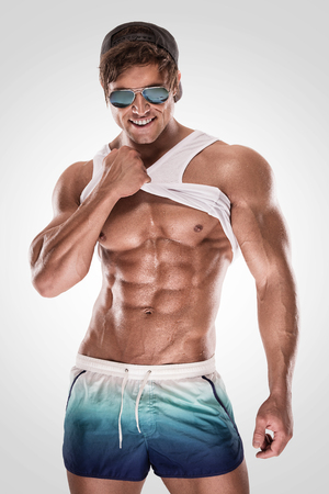 nude male body: Sexy muscular fitness man showing sixpack muscles without fat over white background Stock Photo