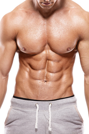 naked male body: Strong Athletic Man  showing muscular body and sixpack abs over white background