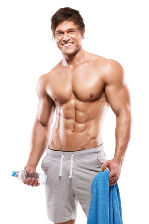 nude abs: Strong Athletic Man Fitness Model Torso showing six pack abs. holding bottle of water and towel
