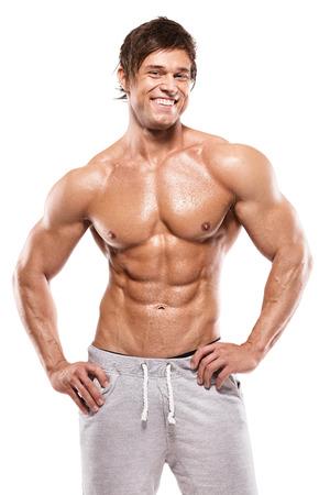 desnudo masculino: Fuerte Hombre atlético que muestra el cuerpo muscular y sixpack abs sobre fondo blanco