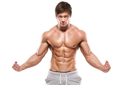 nudo maschile: Forte uomo atletico che mostra il corpo muscoloso e abs sixpack su sfondo bianco