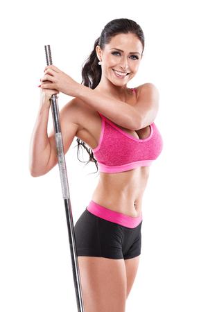 tetas: Niza mujer sexy haciendo ejercicios con pesa de gimnasia grande sobre fondo blanco, retocada