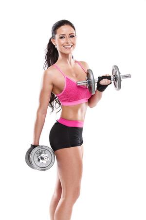 Mooie sexy vrouw training met grote halter op witte achtergrond, geretoucheerd Stockfoto