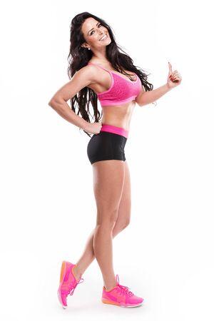 abdominal fitness: presenta aptitud de la mujer atractiva aislada en el fondo blanco Foto de archivo