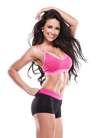 donne mature sexy: posa fitness donna sexy isolato su sfondo bianco