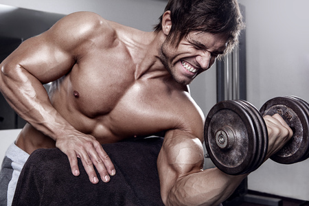 boy  naked: young muscular sexy man workout in gym - biceps closeup Stock Photo