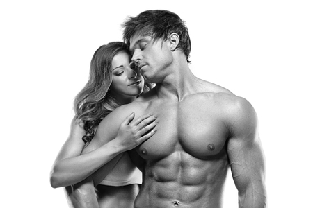 topless brunette: sexy couple, muscular man holding a beautiful woman isolated on a white background