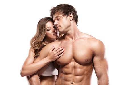 young woman nude: sexy couple, muscular man holding a beautiful woman isolated on a white background