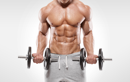 man lifting weights: Muscular bodybuilder guy doing exercises with dumbbells over white background