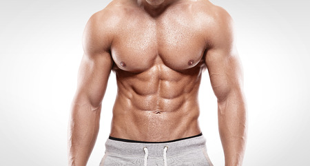 nude abs: Strong Athletic Man  showing muscular body and sixpack abs over white background