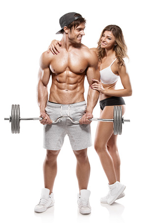 Muscular bodybuilder guy with woman doing exercises with dumbbells over white background