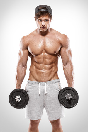 workout gym: Muscular bodybuilder guy doing exercises with dumbbells over white background