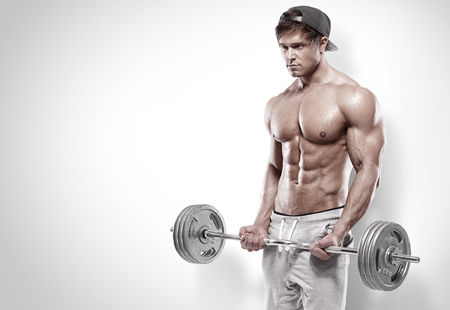 workout gym: Muscular bodybuilder guy doing exercises with big dumbbell over white background