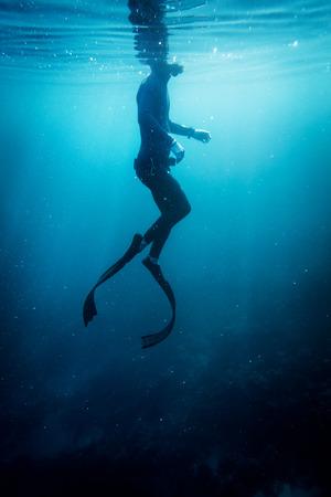 wetsuit: Freediver in wetsuit neoprene swim in the sea