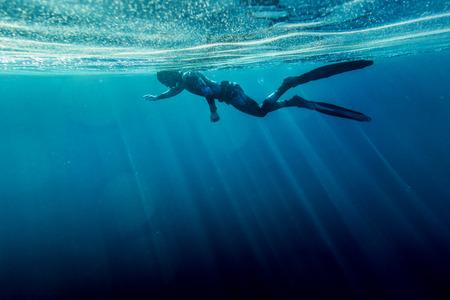 neoprene: Freediver in wetsuit neoprene swim in the sea