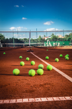 red clay: Tennis Balls on a tennis court with copy space