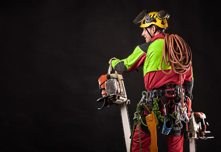lumberjack with chainsaw isolated over black background Archivio Fotografico