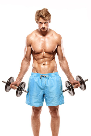 retouched: Muscular bodybuilder guy doing exercises with big dumbbells over white background