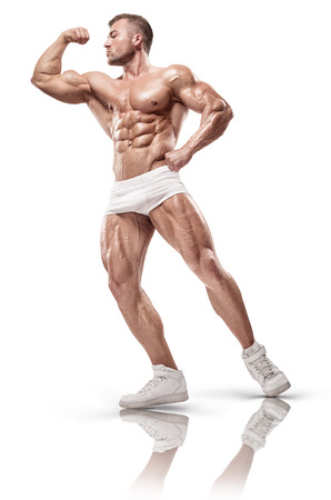 sixpack: Muscular bodybuilder guy front biceps posing over white background Stock Photo