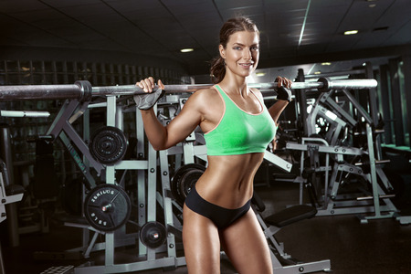 sexy women naked: beautiful sporty sexy woman doing squat workout in gym