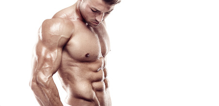 muscle guy: Muscular bodybuilder guy standing and posing triceps muscle