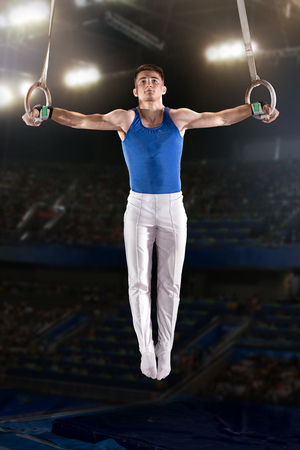 portrait of young man gymnasts competing in the stadium Фото со стока - 80731001